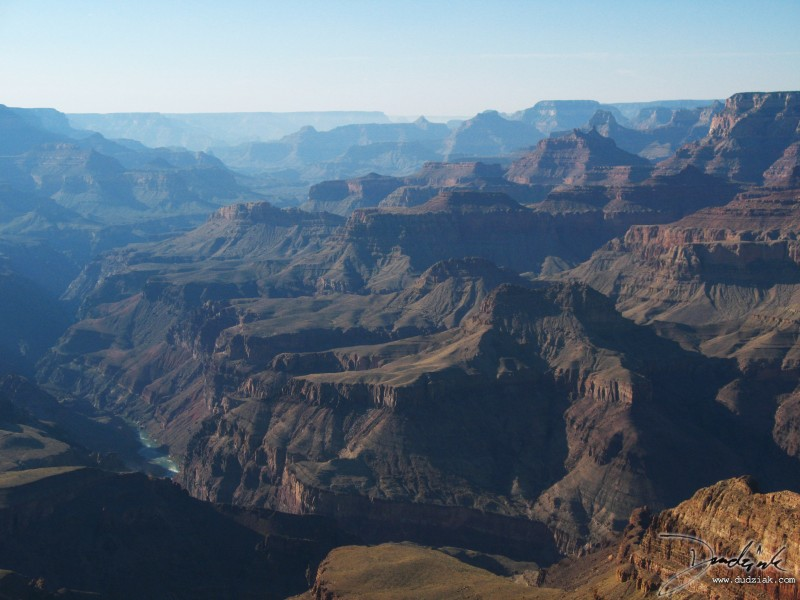 Grand Canyon from the southern slope looking West.  The Colorado River is visible in the bottom left.  For perspective, the Colorado is at least 200ft (60m) wide in these shots and the farthest visible point is approximately 40mi (65km) away.