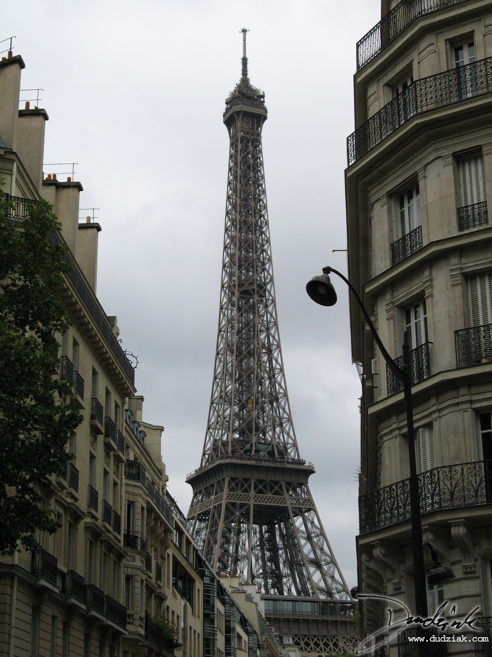 Picture of the Eiffel Tower (Tour Eiffel) as seen from the streets of Paris.  This picture was taken from south-east of the tower.