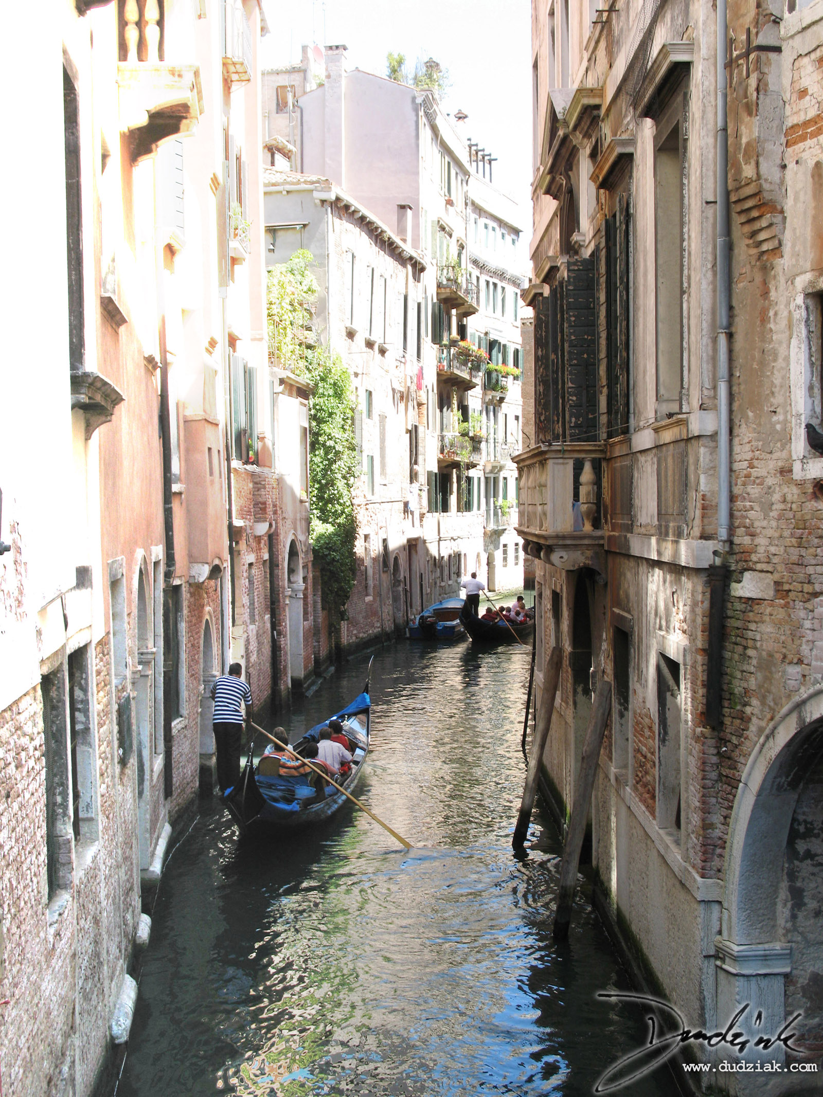 Picture of gondoliers on the Venetian canal Rio di Santa Maria Formosa facing North in Venice, Italy.<br><br>[Lat, Long]:[45.43685772149039, 12.3416268825531]