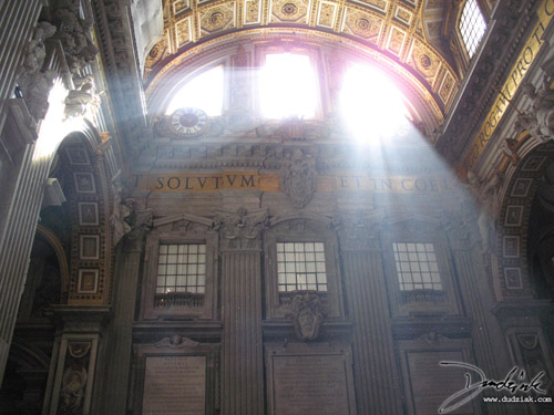 "This picture is of high above the rear (enterence) of St. Peter's Basilica in the Vatican City.<br><br>The latin words seen on the wall are part of the phrase ""Quodcumque ligaveris super terram, erit ligatum etin coelis: et quodcumque solveris super terram, erit solutum et in coelis"" meaning ""I will entrust to you the keys of the kingdom of heaven. Whatever you declare bound on earth shall be bound in heaven; and whatever you declare loosed on earth shall be loosed in heaven."" from Matthew 16:19."