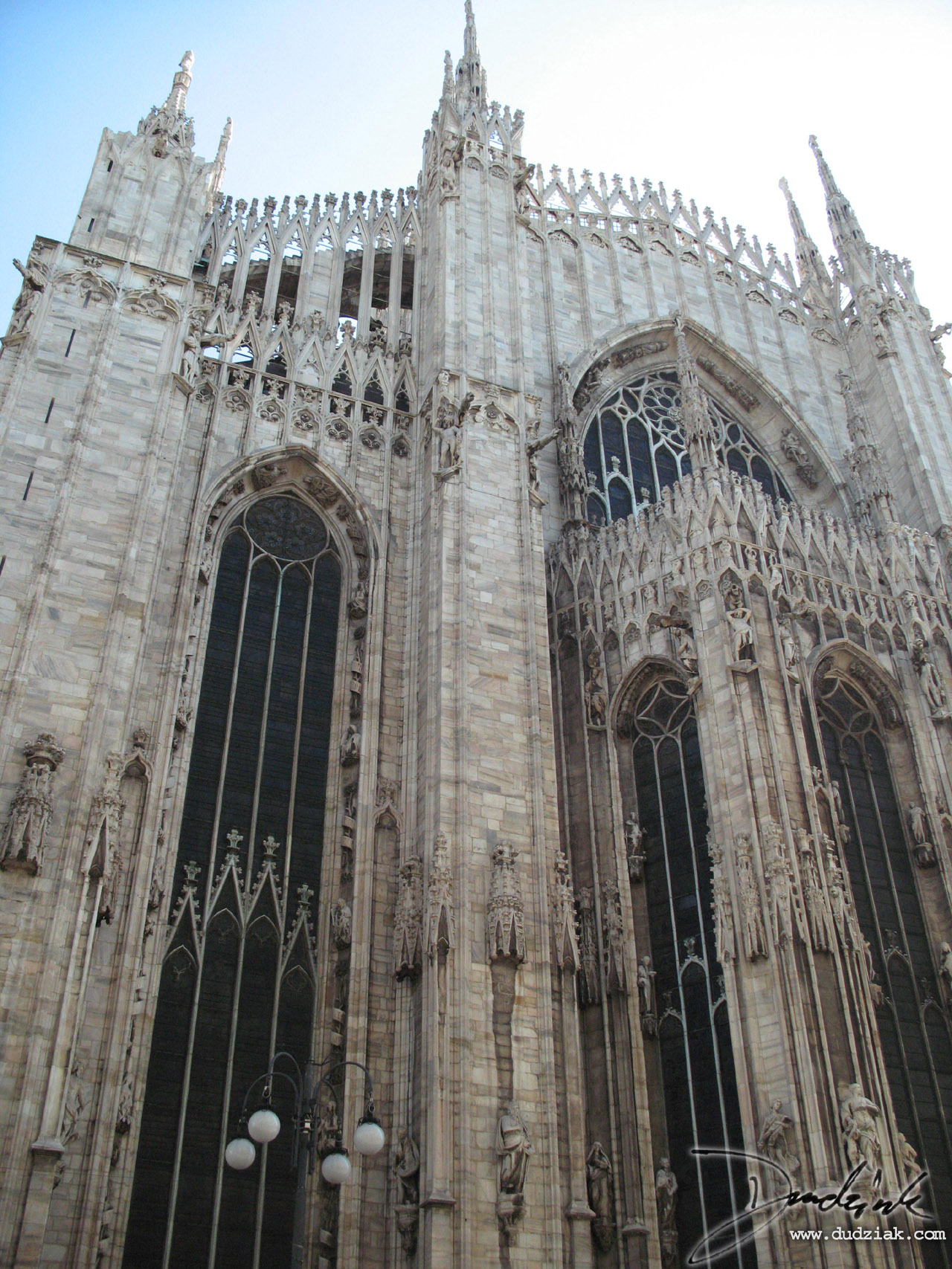 Picture of the Cahtedral of Milan (Il Duomo) and its amazing gothic architecture rear view.  The main staind-glass window can be seen.