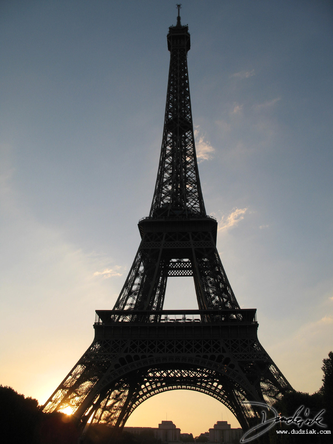 Picture of the Eiffel Tower in Paris at sunset.  Picture taken from the Champ de Mars on Bastille Day.