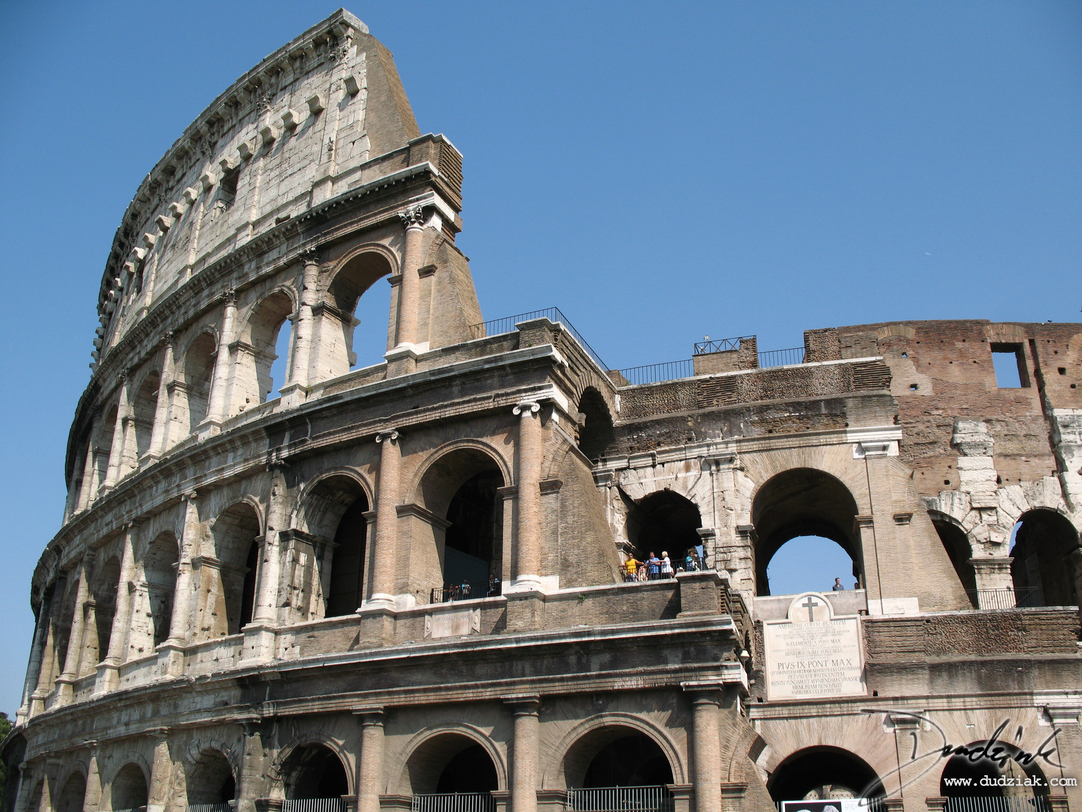 Picture of the Roman Colosseum showing the section where the exeterior wall is partialy collapsed.  Rome, Italy.