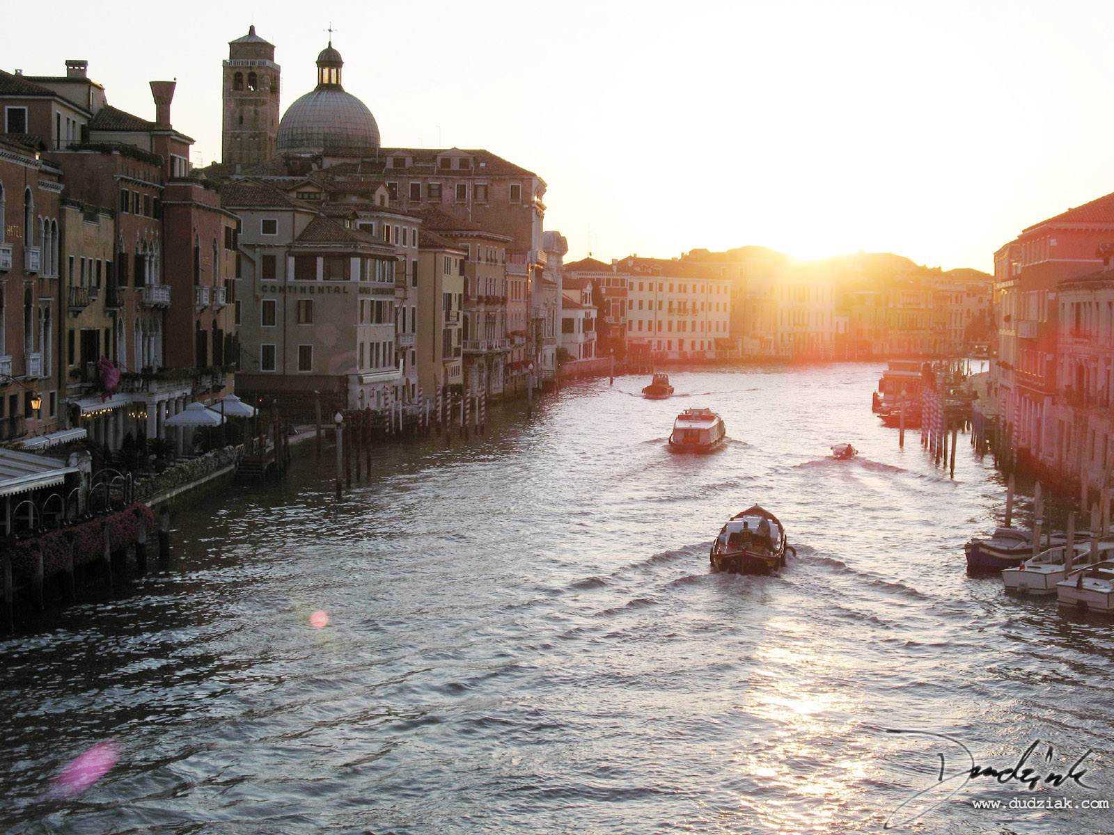 Picture of Venice's Grand Canal, taken at Sunrise.  I took this picture as I was leaving Venice at about 6:15 in the morning, crossing the Grand Canal at Ponte degli Scalzi for the last time.<br><br>[Lat, Long]:[45.44109603418056, 12.322733402252197]