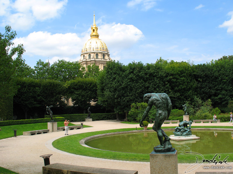 Picture of the sculptures in the Rodin Garden at the Rodin Museum (Musee Rodin) in Paris with the dome of Les Invalides in the background.