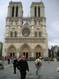Martin Green Standing in Front of the Notre Dame Cathedral