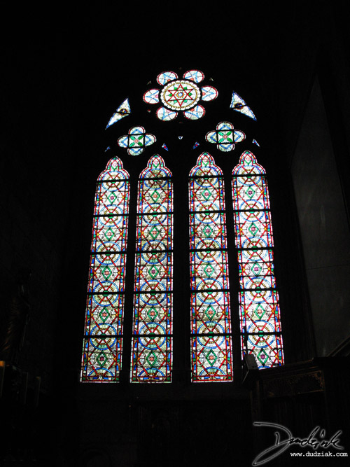 Picture of a stained glass window in the Notre Dame Cahtedral in Paris.