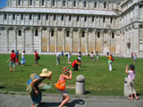 People Posing for Pictures with the Leaning Tower
