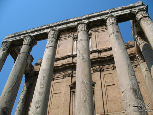 Frontal wider-angle picture of the Temple of Antoninus and Faustina in the Roman Forum in Rome, Italy.