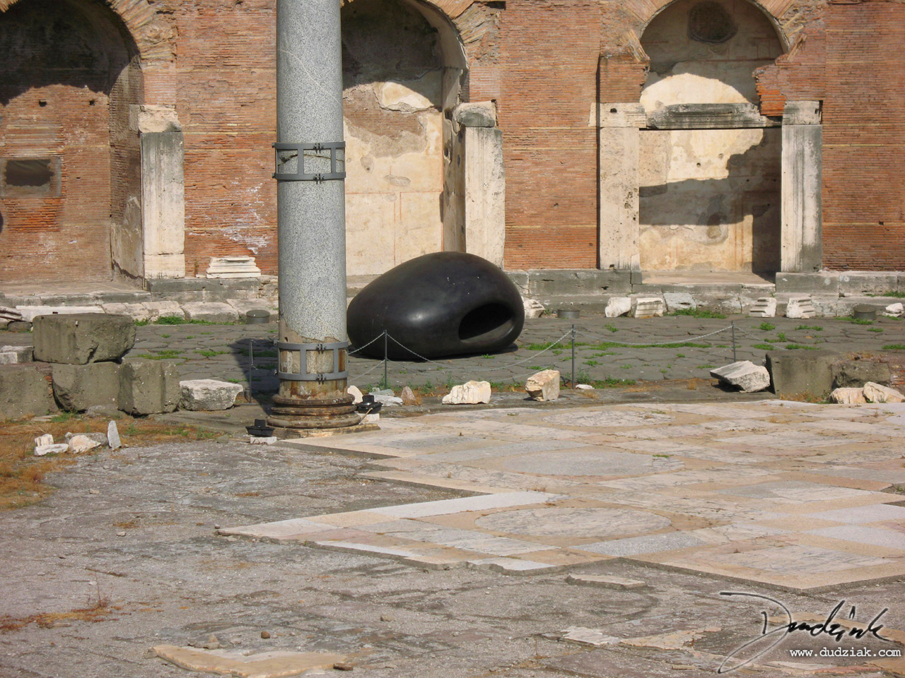 Picture of a large black stone in the Trajan Markets in Rome.
