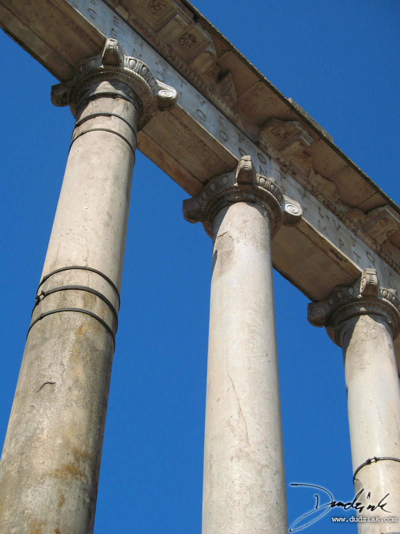 Three of the remaining columns and lentel of the Temple of Saturn in the Roman Forum in Rome, Italy.