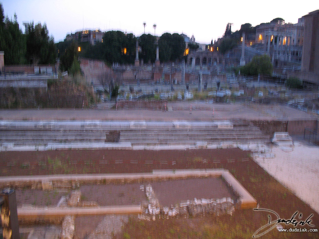 Picture of the roman forum at dusk.