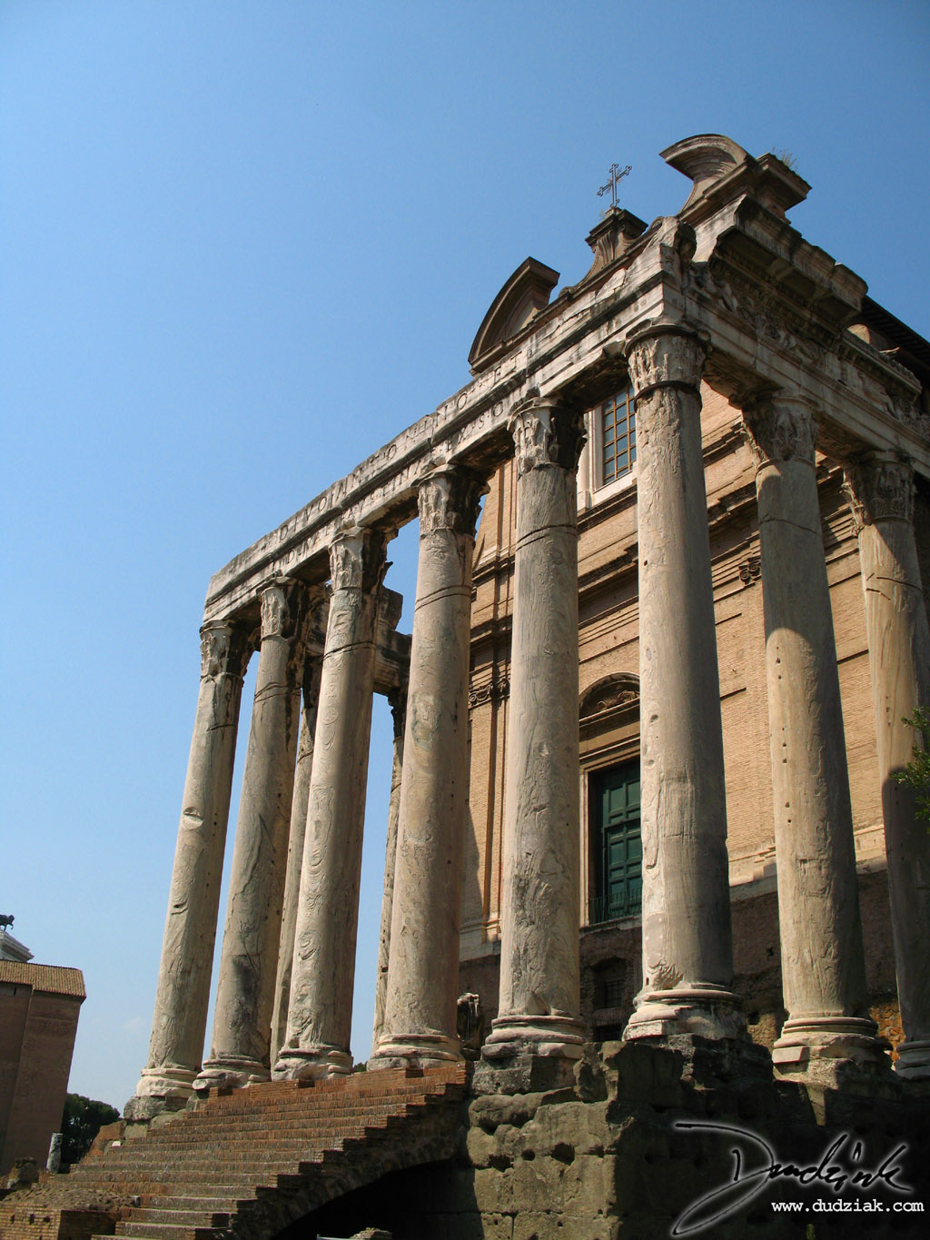 Side-Angle picture of the Temple of Antoninus and Faustina in the Roman Forum in Rome, Italy.