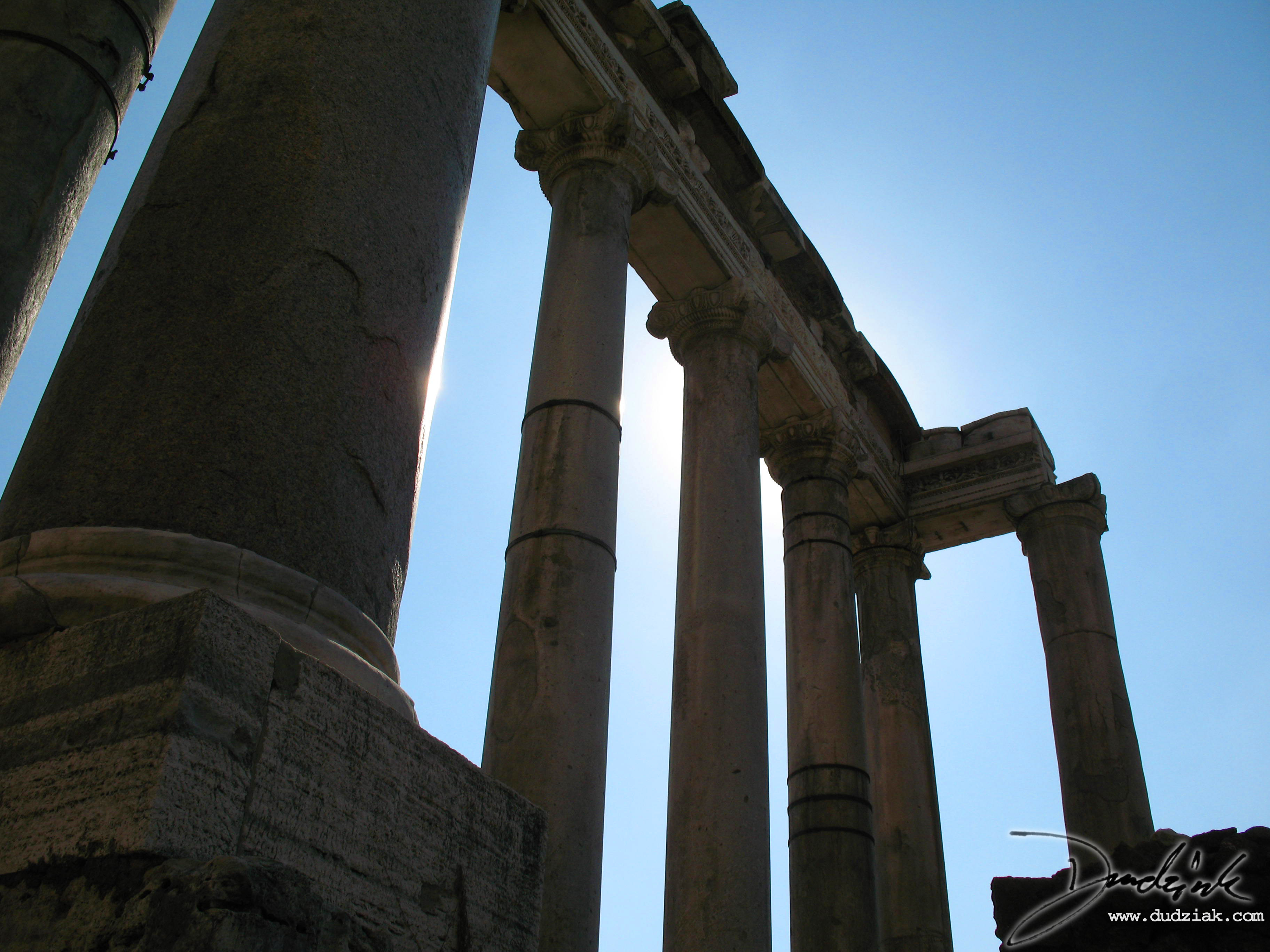 Picture of the remaining columns of the Temple of Saturn in the Roman Forum in Rome, Italy.