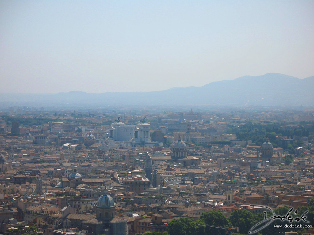 Picture of the city of Rome as seen from the balcony of Saint Peter's Basilica dome.  The Colosseum can be seen in the distance in the center.
