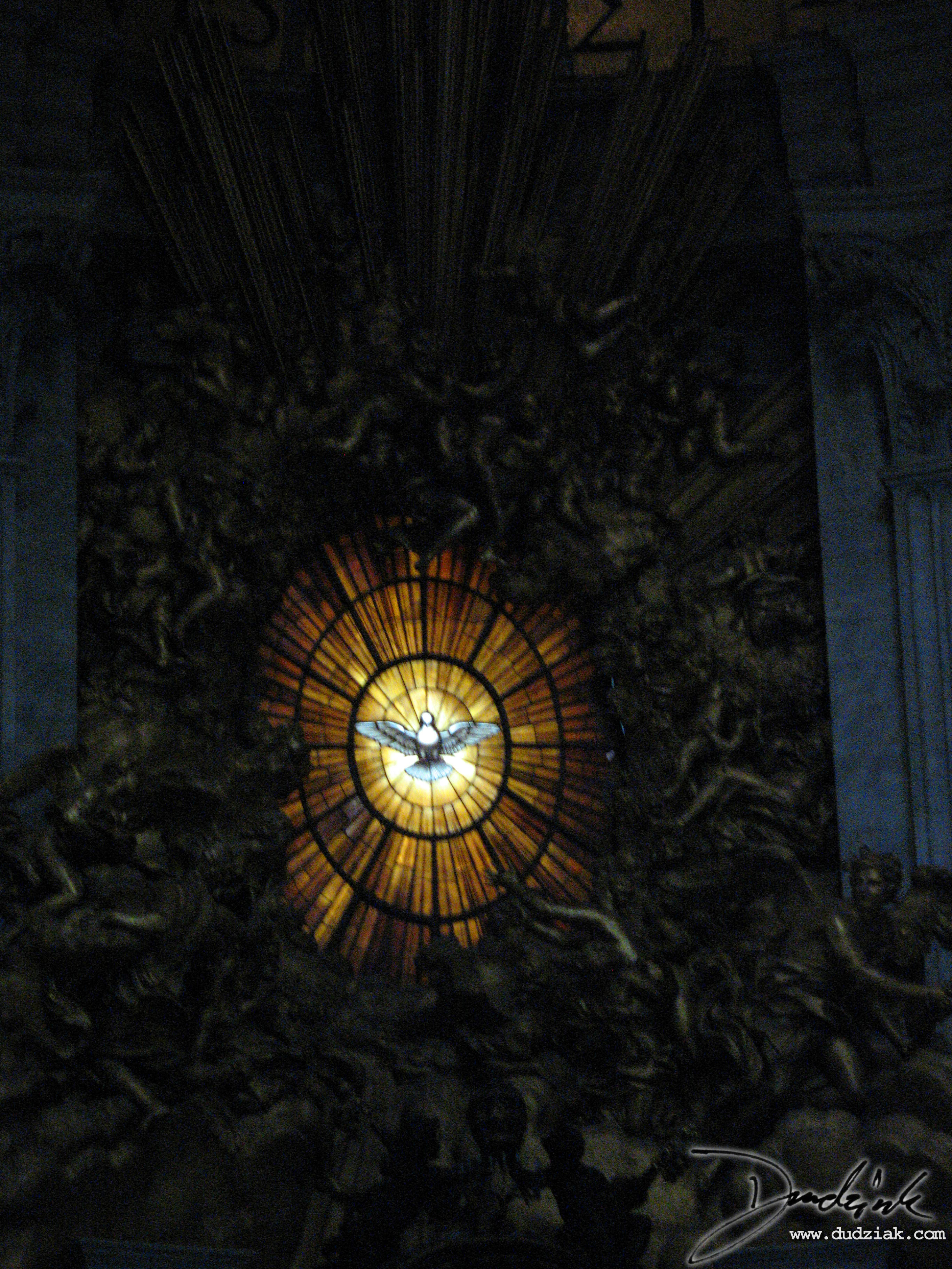 Picture of stained glass window overlooking the Chair of Saint Peter in Saint Peter's Basilica.