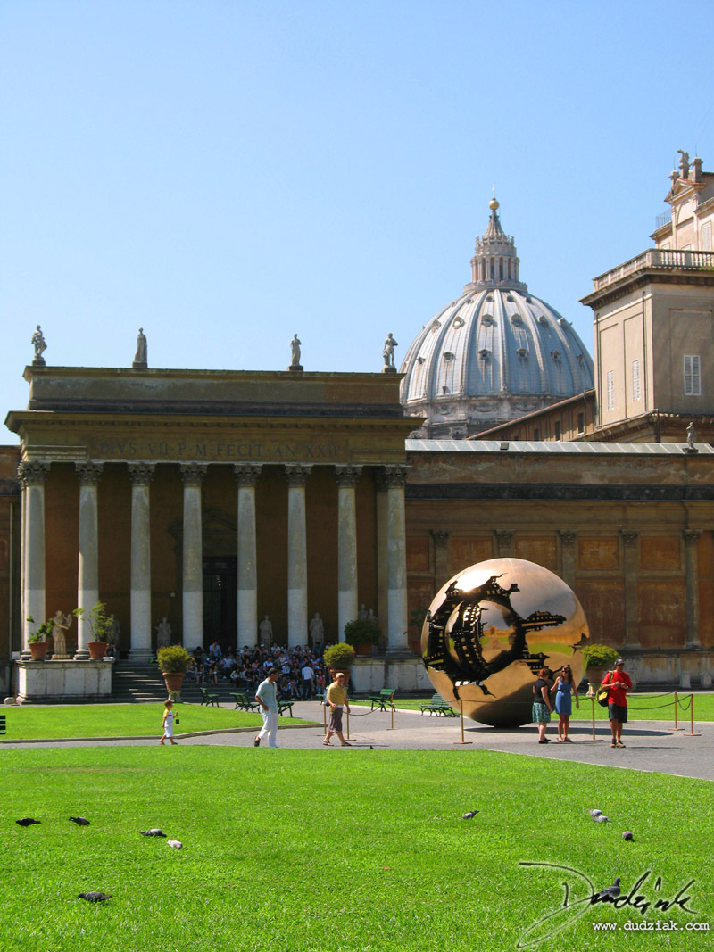 Vatican Museum courtyard with Saint Peter's Basilica dome in the background.