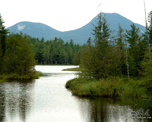 Picture of a quiet river with Mt. Katahdin in the background.