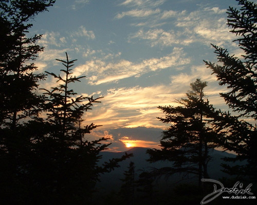 Picture of a sunset over the mountains.  Taken during an evening descent from Mt. Katahdin in Maine.